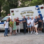 HSCBA Treasurer Jim Wink presents check to Blue Ridge VFD Treasurer Mike Sprenger with members from both groups present.